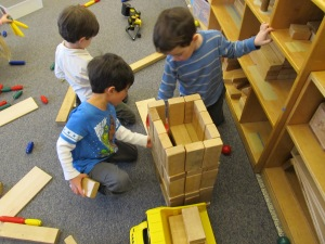 Tucker, Sam and Ollie building a piggy mansion